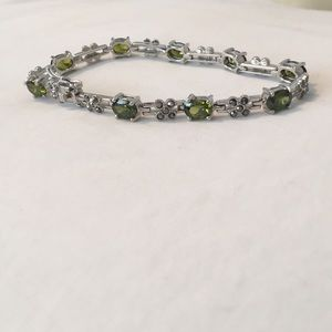Silver clasp bracelet with olive green gems